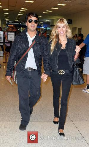 Luis Fonsi and Agueda Lopez are sighted at Miami International Airport  Miami, Florida - 18.05.12