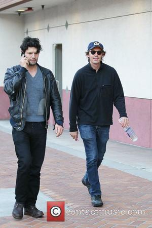 Lukas Haas and a friend outside Rite Aid Pharmacy in Beverly Hills Los Angeles, California - 21.12.11