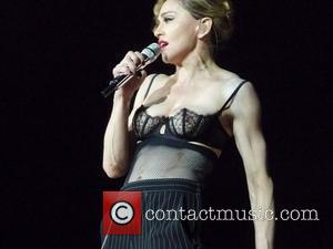 Madonna Keeps To Tight Curfew At London Gig As Ex Checks Out The Show