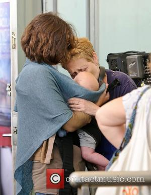 Maggie Gyllenhaal carries daughter named Gloria Ray Sarsgaard on the set of 'Very Good Girls.' New York City, USA -...