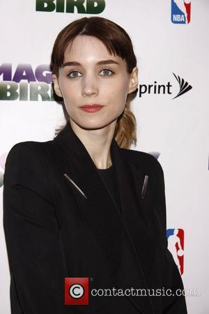 Rooney Mara and Larry Bird
