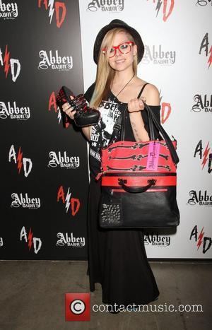 Avril Lavigne visits Abbey Dawn booth at the 2012 MAGIC Convention at Las Vegas Convention Center - Day 2 Las...