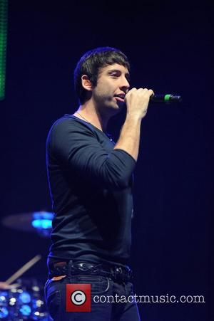 Example,  performing at the Key 103 Jingle Ball at Manchester Arena. Manchester, England - 05.12.12
