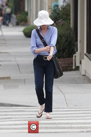 Marcia Cross wearing a large sun hat and Havaianas flip flops out and about on Montana in Brentwood Los Angeles,...