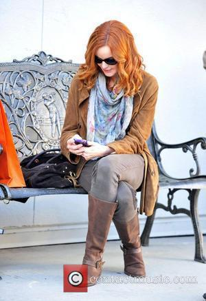 Red head Marcia Cross shopping at Ralph Lauren in Beverly Hills, coordinates her jacket and shopping bag with her fiery...
