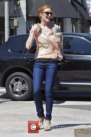 Marcia Cross  leaving the Coffee Bean and Tea Leaf in Santa Monica with an iced coffee beverage. Marcia was...