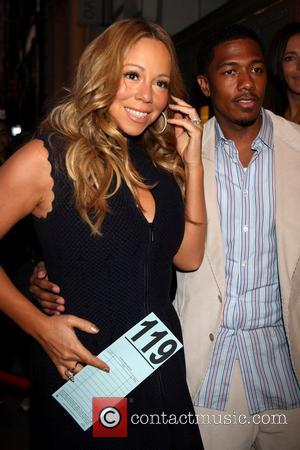Mariah Carey And Nick Cannon Bid Big At Charity Auction