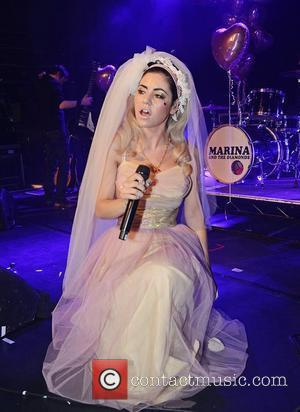 Marina Diamandis of Marina and The Diamonds performs in a wedding dress at G-A-Y London, England - 14.04.12
