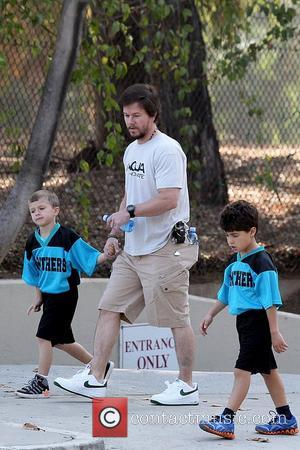 Mark Wahlberg and Michael Wahlberg Mark Wahlberg at a park in Brentwood with his wife and children, for his son's...