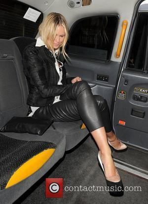 A camera-shy Elle Macpherson out and about in Mayfair. London, England - 19.06.12