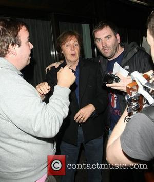 Paul McCartney is mobbed by autograph hunters as he leaves Cecconi's Restaurant London, England - 14.07.12