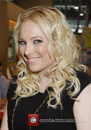 Author Meghan McCain with her upcoming book 'America, You Sexy Bitch: A Love Letter to Freedom' at Book Expo 2012...