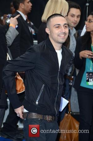 Adam Deacon Carries Dvds Of His Films After Police Searches