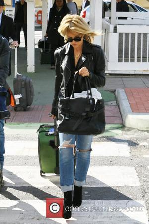 Mena Suvari arrives at Heathrow Airport to catch a departing flight London, England - 04.10.12