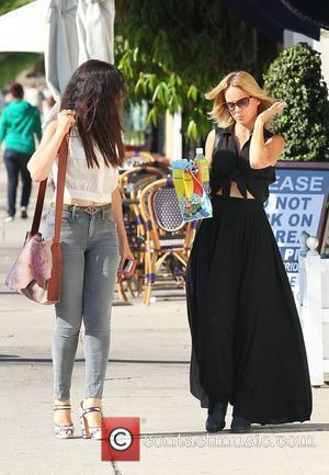 Mena Suvari and a friend shopping on La Brea Avenue West Hollywood, California - 04.09.12