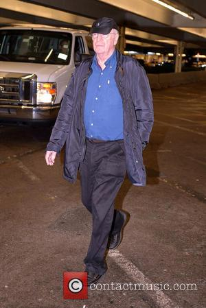 Sir Michael Caine Sir Michael Caine, his wife Shakira Caine and their family arrive at Miami International Airport  Featuring:...