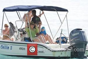 Manchester United midfielder, Michael Carrick on a boat trip with wife Lisa who holds her son Jacey while on holiday...