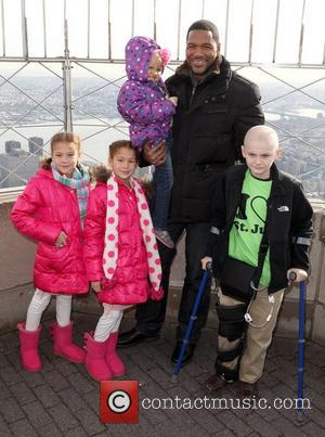 Michael Strahan along with patients from St. Jude Children's Research Hospital, light the Empire State Building in honour of St....