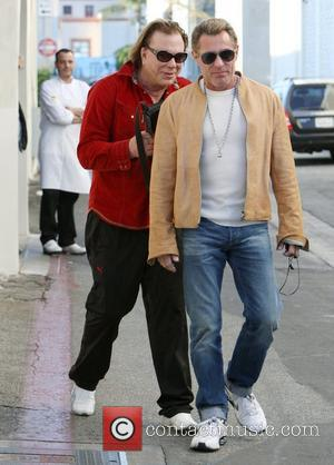 Mickey Rourke exits Cafe Roma in Beverly Hills wearing a red shirt and Ferrari sweatpants Beverly Hills, California - 03.12.11