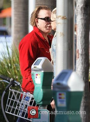 Mickey Rourke kisses his girlfriend Anastassija Makarenko before he heads to meet friends for coffee Beverly Hills, California - 03.12.11