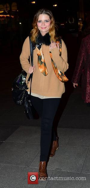 Mischa Barton  wearing a ring on her engagement finger as she arrives for the afterparty for the official opening...