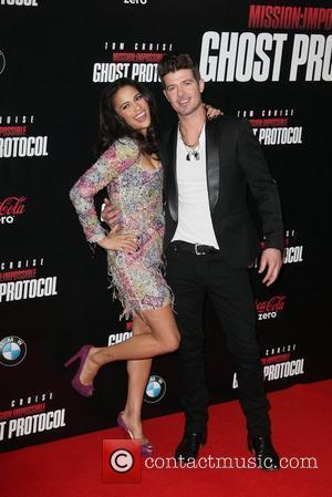 Paula Patton, Robin Thicke  New York Premiere of ''Mission: Impossible - Ghost Protocol'' at the Ziegfeld Theatre - Arrivals...
