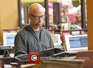 Moby pulls a funny face while paying for his shopping bill at Gelson's Supermarket in Beverly Hills Los Angeles, California...