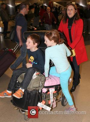 Molly Shannon; Stella Shannon Chestnut; Nolan Shannon Chestnut Molly Shannon pushes her luggage as she arrives at LAX airport with...