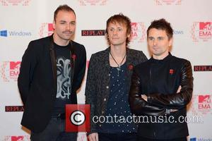 Christopher Wolstenholme, Dominic Howard, Matthew Bellamy and Muse