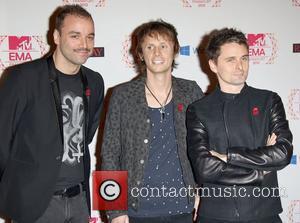 Musicians Chris Wolstenholme, Dominic Howard, Matthew Bellamy and Muse