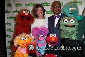 Sherrie Westin, Elmo, Melvin Ming, and the rest of Sesame Street Muppets Jon Stewart with Elmo and The Sesame Street...