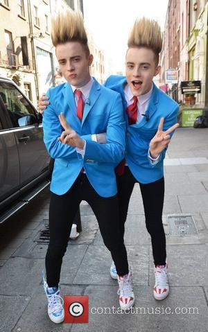 Jedward twins John and Edward Grimes pose outside Muzu TV studios on South Williams Street and get into a game...