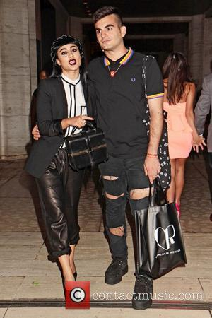 British singer Natalia Kills  seen with a male companion exits the Charlotte Ronson runway show.  New York City,...