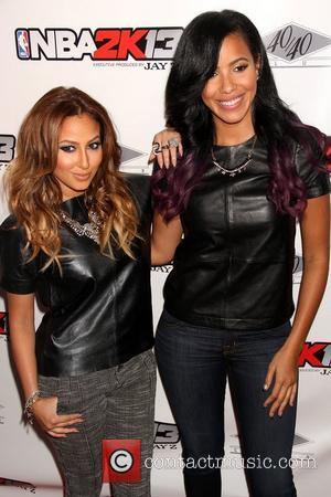 Adrienne Bailon and Guest