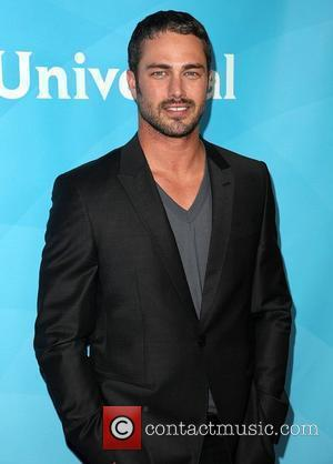 Taylor Kinney and Beverly Hilton Hotel