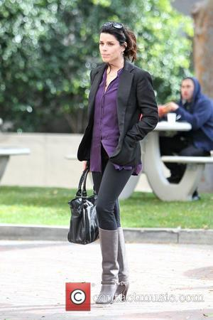 Neve Campbell  arrives at an office building in Beverly Hills Los Angeles, California - 01.12.11