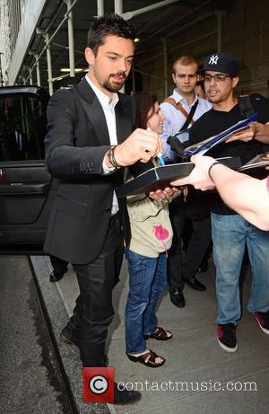Dominic Cooper greets fans and signs autographs outside his New York hotel New York City, USA - 18.06.12