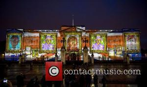 Face Britain, a light show of over 200,000 self portraits of children is projected onto Buckingham Palace to form a...