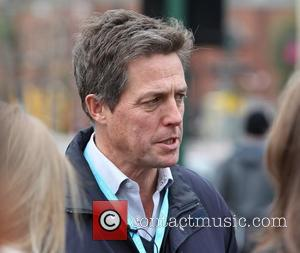 Hugh Grant leaving the Conservative Party Conference 2012 Birmingham, England - 10.10.12