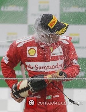 Felipe Massa on the podium at the Brazilian Formula 1 Grand Prix at the Interlagos circuit. Sao Paulo, Brazil -...