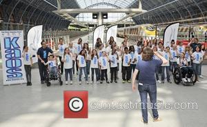 A children's choir sings for the the French Paralympic team as they arrive. The French Paralympic team arrive at King's...