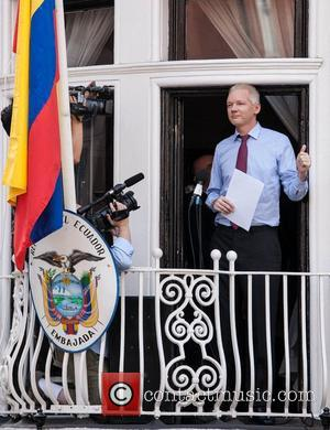 Julian Assange makes a statement from the balcony of the Ecuadorian Embassy in London where he currently stays seeking political...