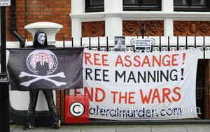 A lone member of the hacktivist group known as 'Anonymous' poses outside the Ecuadorian Embassy in London where WikiLeaks founder...