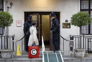 Police officers guard an entrance to The King Edward VII Hospital where the Duchess of Cambridge is resting following a...