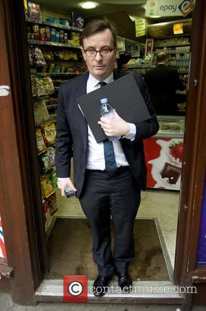 Sky News chief John Riley leaves a newsagent after giving evidence at the Leveson Inquiry held at the Royal Courts...