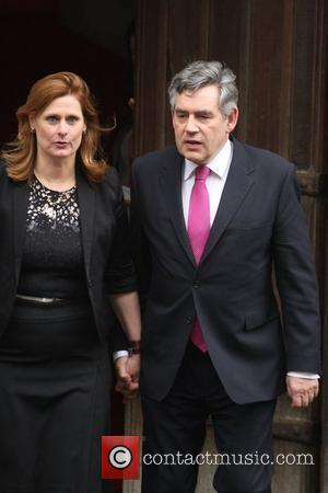 Gordon Brown leaves the Royal Courts of Justice with his wife Sarah Brown after attending the Leveson Inquiry London, England...