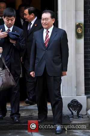 Chinese official Li Changchun (R)  leaves 10 Downing street after a meeting with Chancellor George Osborne and Prime Minister...