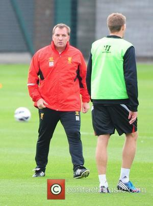 Brendan Rodgers and Steven Gerrard Liverpool FC train ahead of the opening weekend of the new Barclays Premier League season...