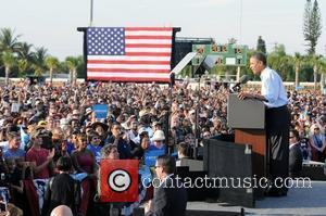 US President Barack Obama speaks at a rally at McArthur High School in Hollywood, Florida, on 4 November, 2012 -...
