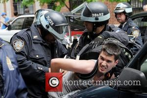 Policemen arrest a protestor during the Occupy Wall Street march Occupy Wall Street protestors march down Fifth Avenue towards Union...